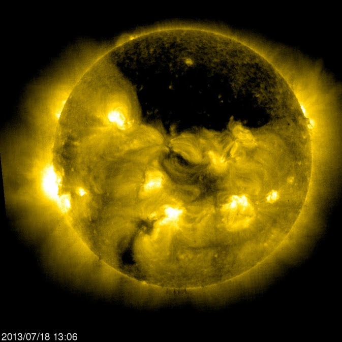 SOHO captured this image of a gigantic coronal hole hovering over the sun's north pole on July 18, 2013.