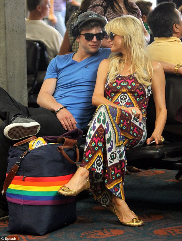 Forgive me: Paris Hilton shows her support for the Gay community by carrying a bag adorned with a Gay Pride Rainbow