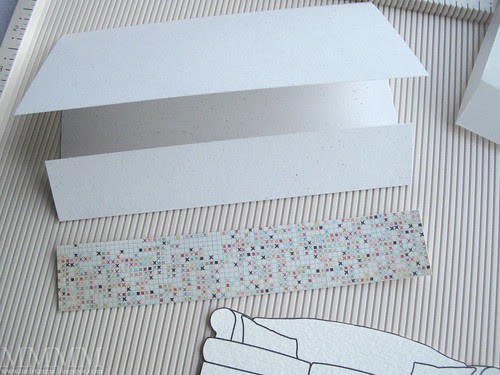 4) Cut a piece of patterned paper to make a rug
