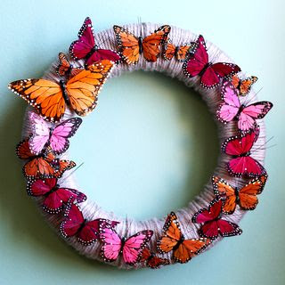 image feather butterfly and yarn wreath