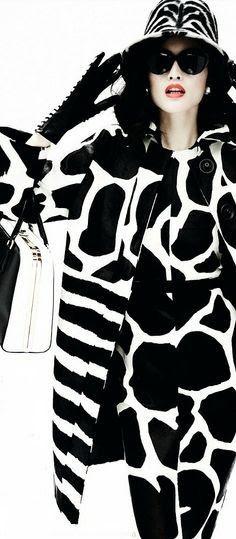 .Sui He by Mario Testino for Vogue China December 2013. Zebra hat, zebra and giraffe coat