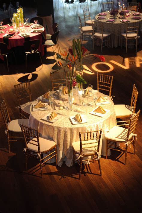 Gold linens with gold chiavari chairs and a centerpiece of