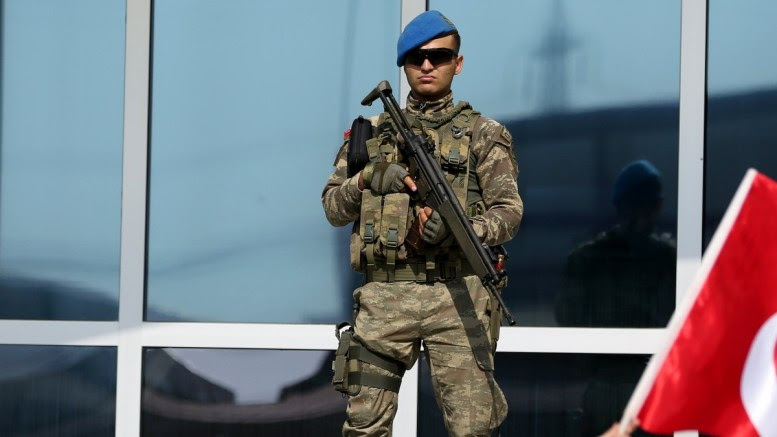 File Photo:  A special forces soldier monitors the area in front of the Prison. EPA, ERDEM SAHIN