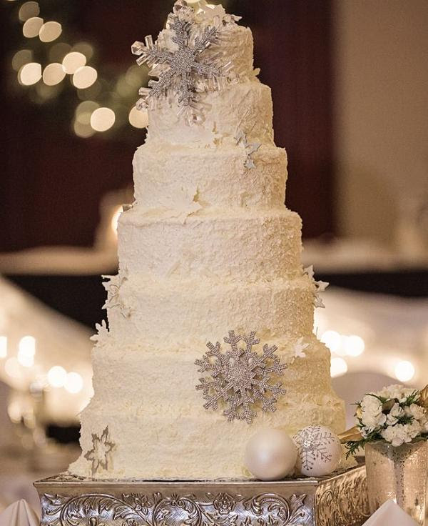 winter wedding cake with snowflake Christmas ornaments