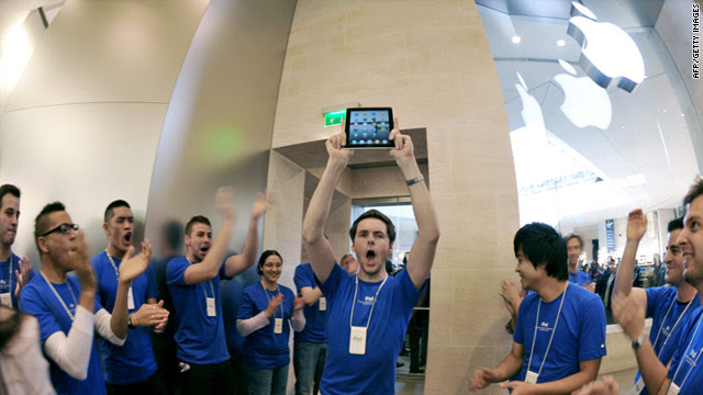 At product launches, Apple store employees cheer for the first customers to buy the company's latest gadgets.