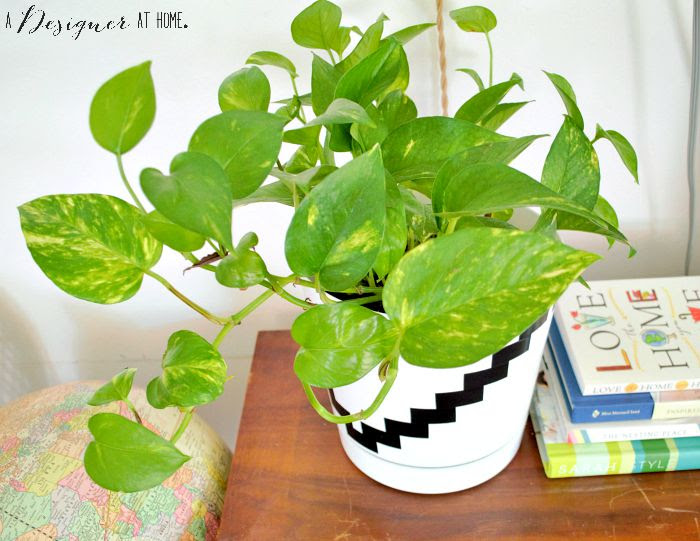 a basic white plastic planter made awesome with tape!