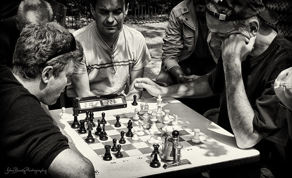 Intense Chess Game - Jardin du Luxembourg - Luxemburg Garden, Paris. These matches are quite serious with all brows furrowed and complete silence - Click for full sized Hi-Res Image - JohnBrody.com -  JohnBrody.blogspot.com