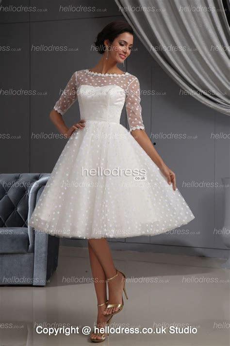 Love this white knee length wedding dress on hellobridal