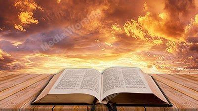 Open Bible on table Sunset V1 Christian Worship Background