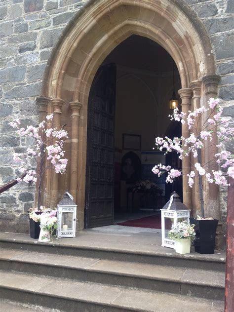 Posy Barn blossom trees outside church   Ceremony   Church
