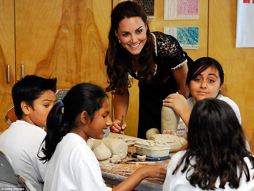 Royal snail  Kate races ahead with her painting at Inner-City Arts  campus whilst William is slow off the mark  8