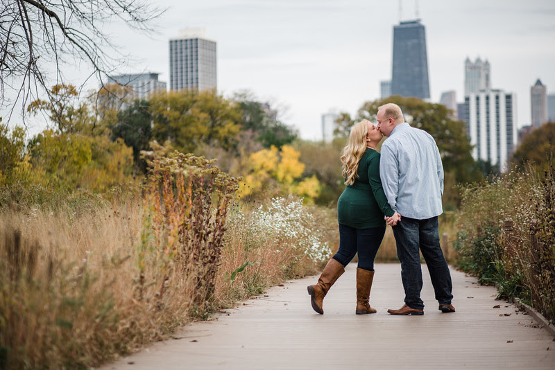 A candid engagement session in Lincoln Park in Chicago IL during the middle of October with brightly colored trees and beautiful weather. We walked through the park and used various locations and went to the lake shore after for a sunset champagne toast.