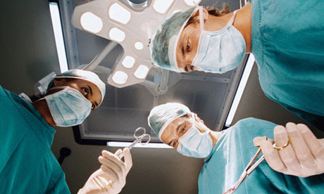 Surgeons looking down on patient