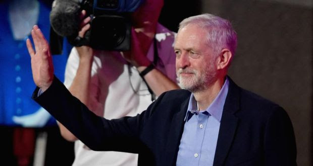 Jeremy Corbyn salutes the crowd shortly after his announcement as new leader of the UK labour party. Photograph: Getty
