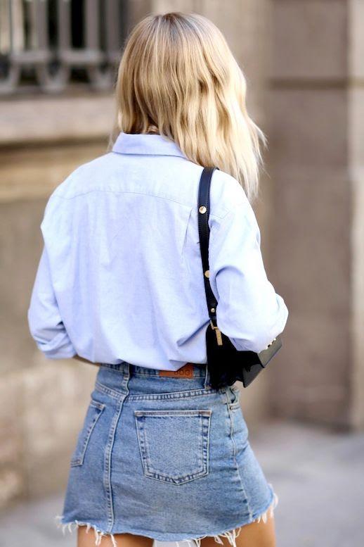 Le Fashion Blog Blogger Style Blonde Wavy Hair Blue Shirt Black Shoulder Bag Short Jean Skirt Via We The People
