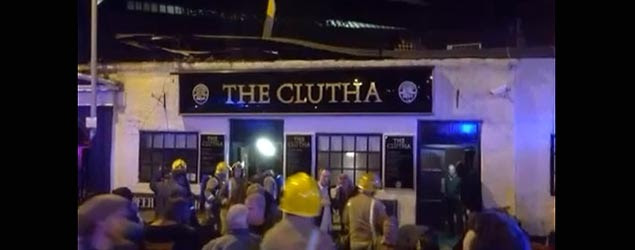 A helicopter crashes into a pub in Glasgow, Scotland. (Screenshot/YouTube)