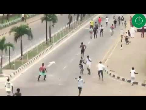 EndSWAT Protesters chase away armed thugs in Alausa, Ikeja, Lagos