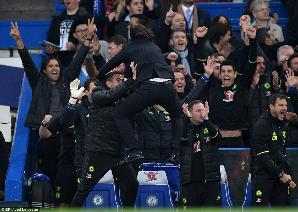 Chelsea manager Antonio Conte goes wild and jumps in the air in celebration with his coaching staff after the fourth goal