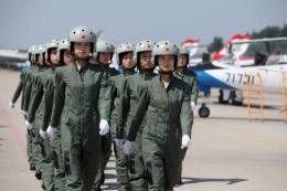 China said Friday a female astronaut will be among the three-person team on board the Shenzhou-9 spacecraft