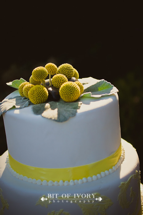 yellow and gray floral wedding cake