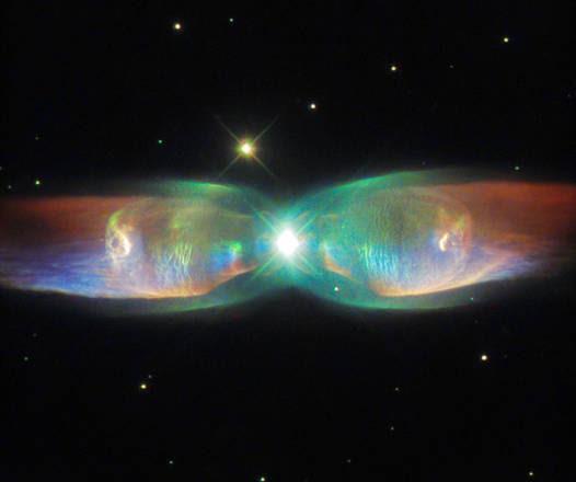 Farfalla cosmica immortalata dal telescopio Hubble (fonte: ESA/Hubble & NASA. Judy Schmidt)
