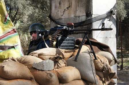 A Syrian soldier manning a checkpoint near Damascus