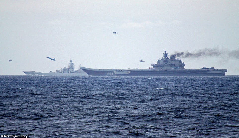 Russian pilots conducted flight operations from the deck of the Admiral Kuznetsov carrier, pictured belching smoke, with the nuclear-powered Peter the Great guided missile cruiser shadowing in the background on their way to Dover