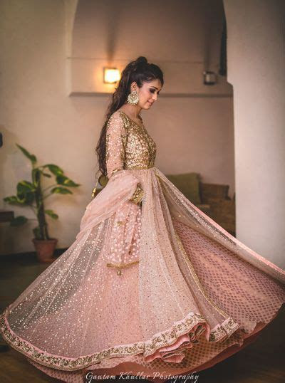 twirling bride shot in peach and gold anarkali   Bridal