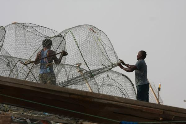 Photograph of Fishermen arranging the nets on top of their boat - Qatar - Asia