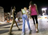 BRAZIL - JULY 16:  Prostitutes work in the Copacabana neighborhood of Rio de Janeiro, Brazil, on Sunday night, July 15, 2007. With 700,000 visitors flooding into Rio de Janeiro, the Pan American Games are a profit opportunity for prostitutes in Brazil, where their occupation is legal. They can expect a surge in business and double their usual rates, said Flavio Lenz, a spokesman for Da Vida, a group representing Rio's sex workers.  (Photo by Douglas Engle/Bloomberg via Getty Images)