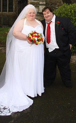 Stephen Beer and Michelle Coombe, are from Plymouth, where 60 per cent of adults are overweight. Thecouple, who weigh more than 54 stone between them and claim £2,000 a month in benefits, have wed in a £3,000 ceremony - paid for by the taxpayer
