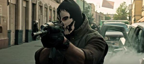 A gunman prepares to open fire on a city street in SICARIO 2: SOLDADO.