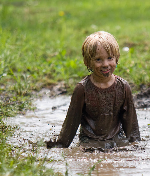 Little-boy-playing-in-mud_large