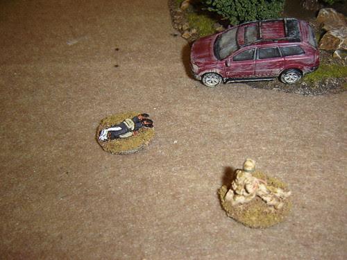 Medic evavuates, putting his pistol to good use