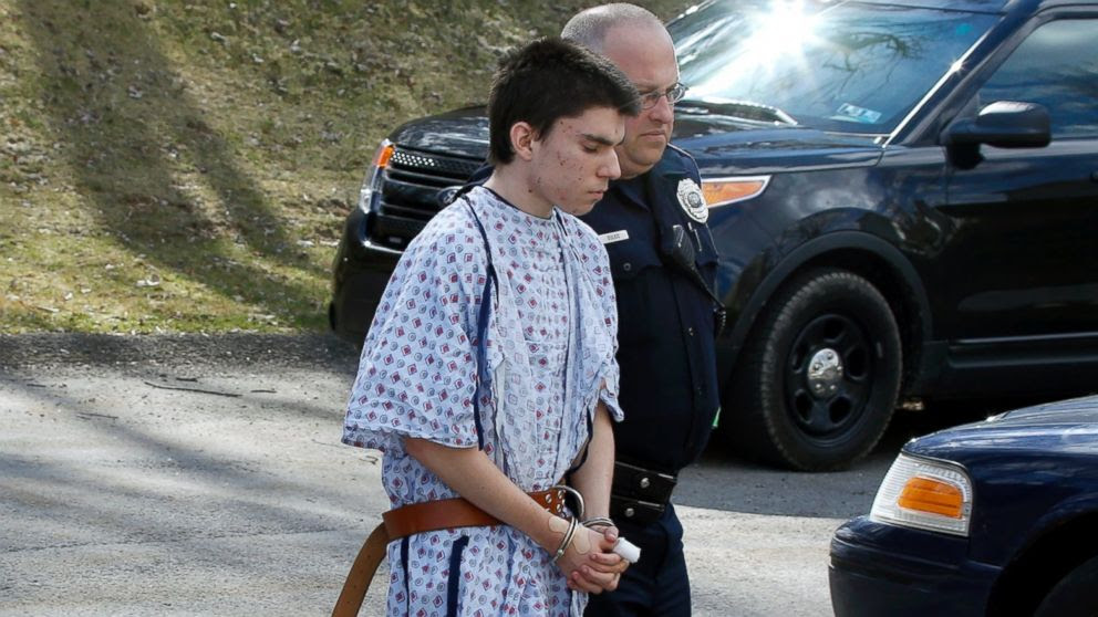 PHOTO: Alex Hribal, the suspect in the multiple stabbings at the Franklin Regional High School in Murrysville, Pa., is escorted by police to a district magistrate to be arraigned, April 9, 2014, in Export, Pa.
