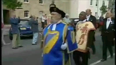 Micheál Ó Comáin wearing a tabard with arms of the Irish State, at 27th International