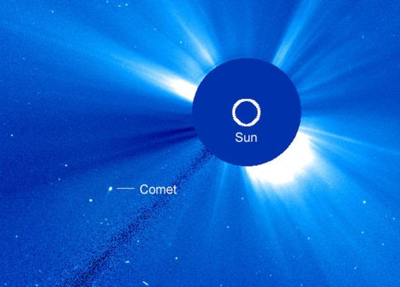 SOHO-2875 seen in a second, wide-field coronograph called LASCO C2 at 2:42 a.m. today Feb. 20. It's already moved a good distance to the west-southwest of the Sun and still displays a short tail. Credit: NASA/ESA
