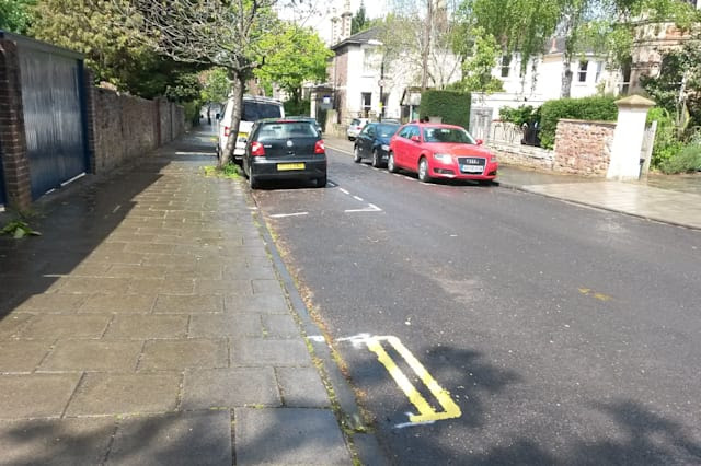 A set of double yellow lines on Leigh Road in Bristol as a council has defended painting the set of double yellow lines measuring less than a metre long on a residential street. PRESS ASSOCIATION Photo. Picture date: Tuesday May 5, 2015. Elected mayor George Ferguson introduced the controversial plans to combat parking problems in parts of the city. Residents have poked fun at the lines - which are more than 50cm shorter than the front of a Smart car - on social media. See PA story SOCIAL Lines. Photo credit should read: Claire Hayhurst/PA Wire