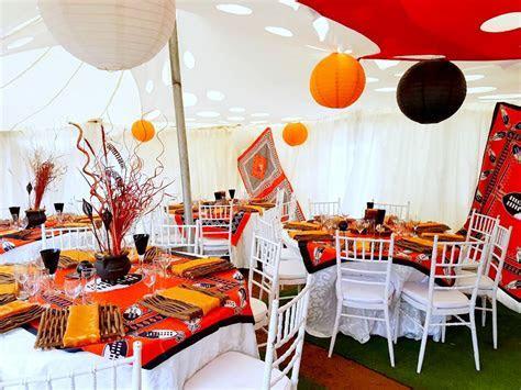 Orange and black traditional wedding decor at Shonga