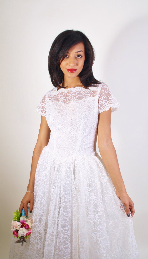 long sleeved 1950s wedding dresses