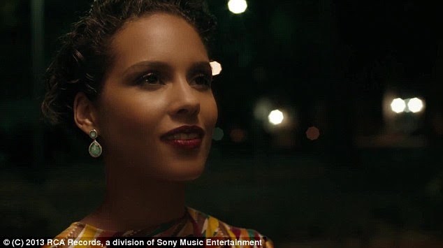 Stunning: Alicia watches her man perform in the smoky venue in the lead-up to their final connection