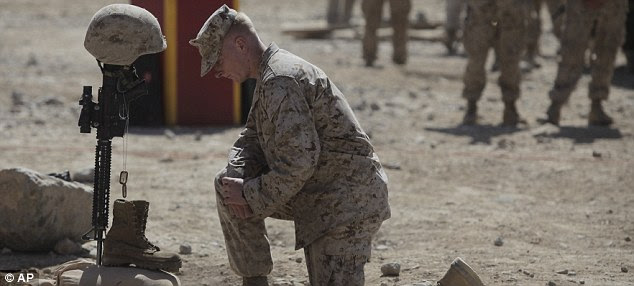 Last respects: U.S. Marine Lt. Jake Godby pays his respects to Lance Cpl. Bernard during a memorial service