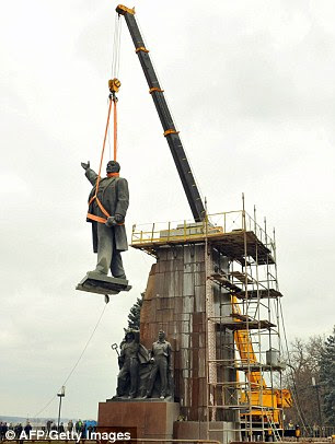 Pictured, the Lenin statue is removed in the Ukranian city of Zaporizhzhya