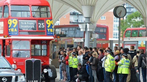 People queue for buses near Stratford station