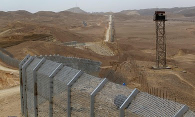 An Egyptian watch tower is seen close to the construction site of a fence on the border between Occupied Palestine and Egypt along Israel's Highway 12, a desert road north of the Red Sea resort of Eilat, February 15, 2012. by Pan-African News Wire File Photos