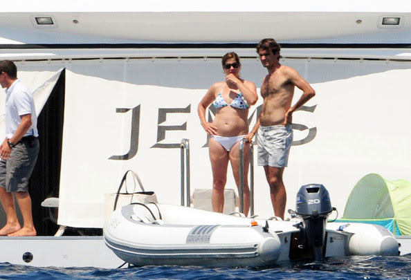Tennis champion Roger Federer enjoys some down time between tournaments by vacationing with wife Mirka in the Mediterranean. They join friends on a yacht and take a dip in the waters before hitting the beach to lay out in the sun.