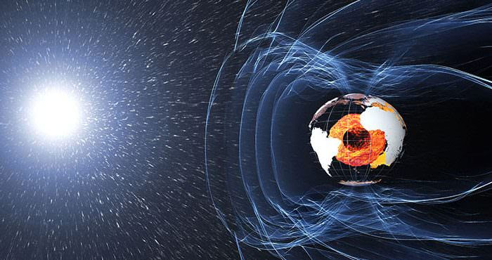 """The magnetic field and electric currents in and around Earth generate complex forces that have immeasurable impact on every day life. The field can be thought of as a huge bubble, protecting us from cosmic radiation and charged particles that bombard Earth in solar winds. It's shaped by winds of particles blowing from the sun called the solar wind, the reason it's flattened on the """"sun-side"""" and swept out into a long tail on the opposite side of the Earth. Credit: ESA/ATG medialab"""