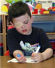 Boy with eye patch