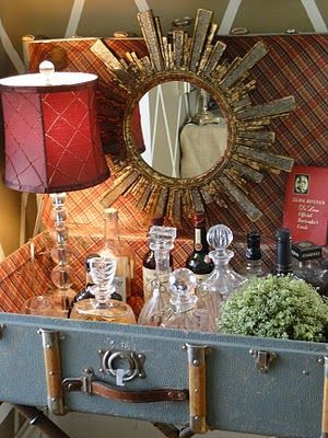 Shaken Not Stirred.  Custom-build a bar yourself with a vintage suitcase and your own flair : )