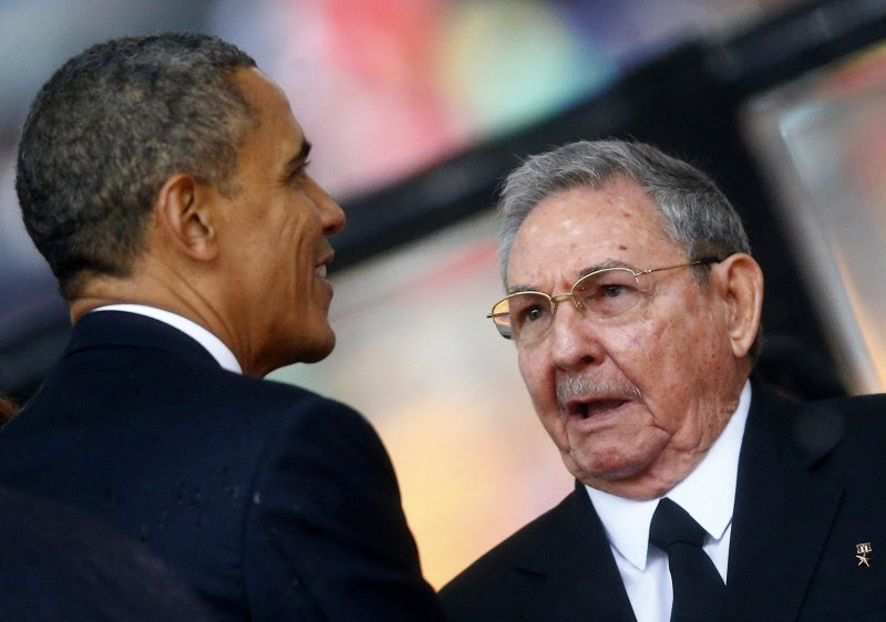 Image: File photo of U.S. President Obama greeting Cuban President Castro at the memorial service for Mandela in Johannesburg
